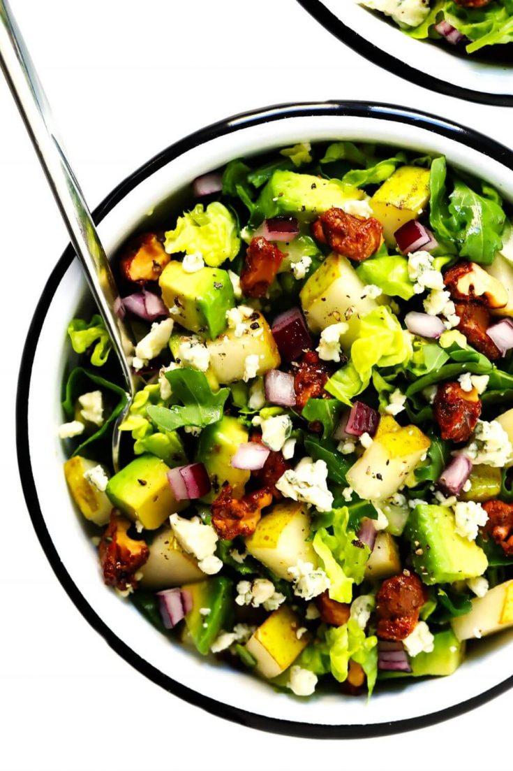 A colorful bowl of pear gorgonzola avocado chopped salad.