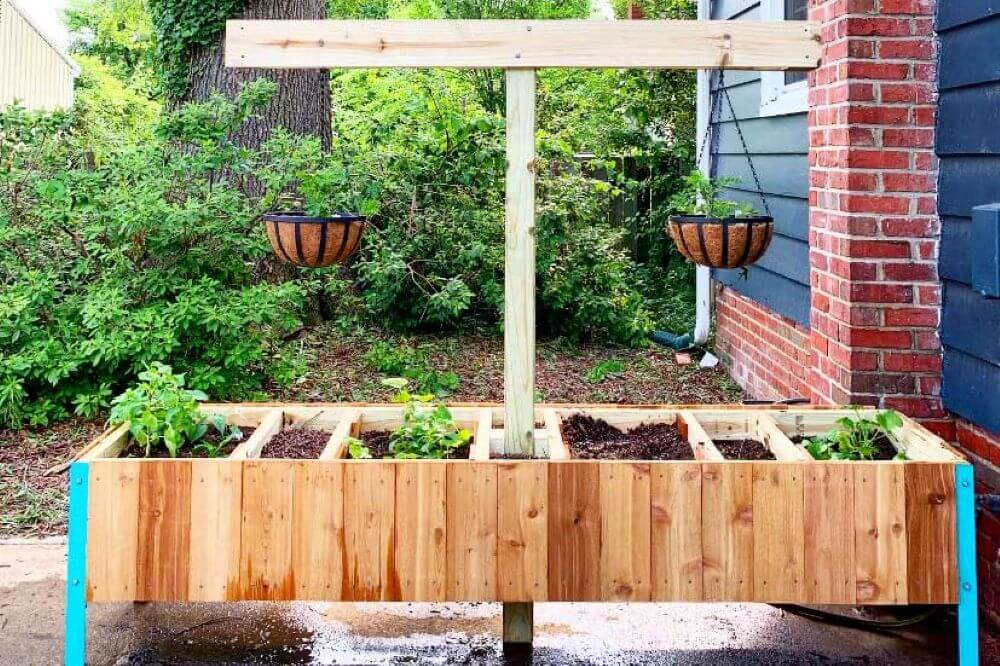 A lovely raised garden bed with compost bins built into it.