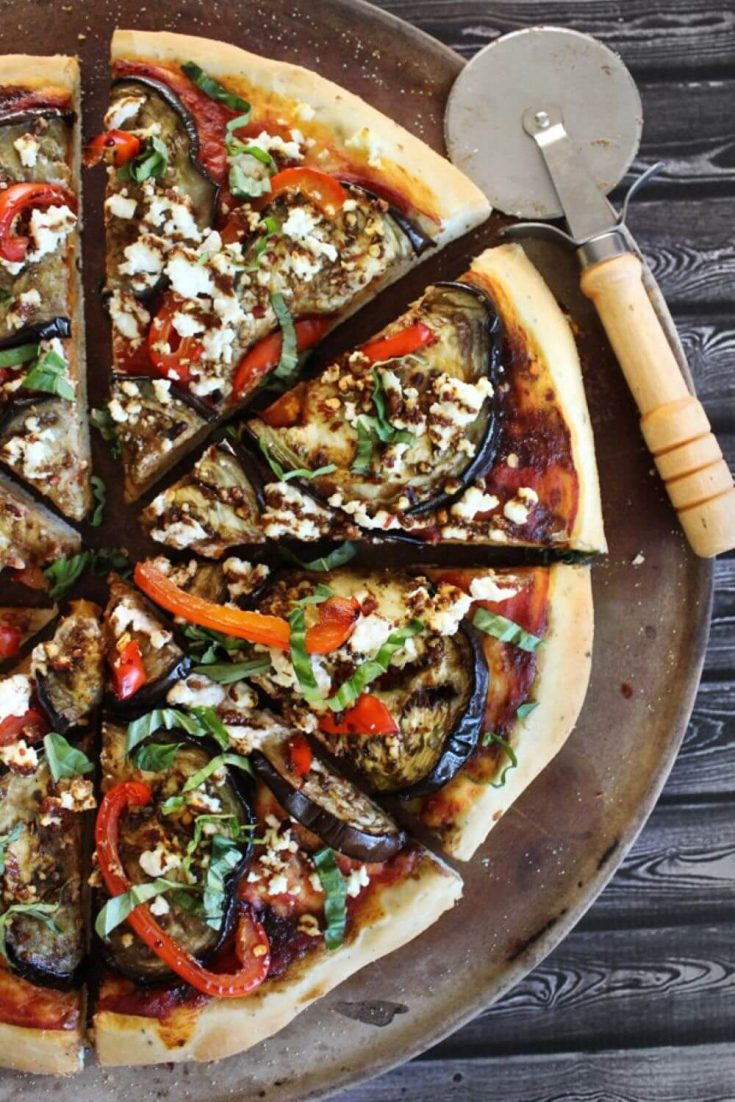 A loaded roasted red pepper eggplant goat cheese pizza.