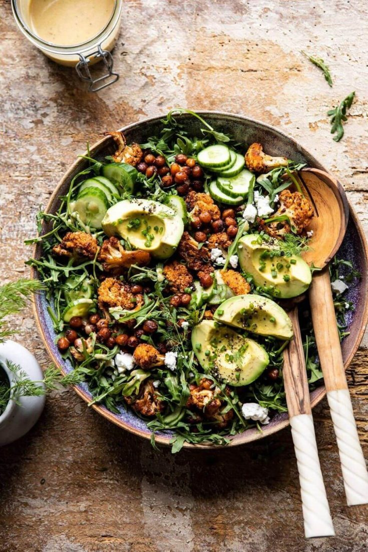 An overflowing bowl of healthy roasted cauliflower salad.