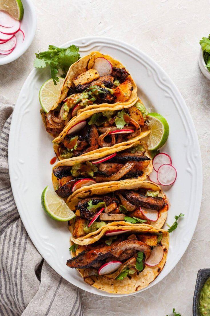 A platter of vegan sheet pan tacos.