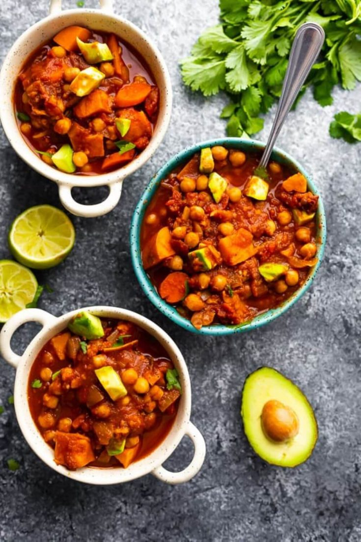 Three full bowls of the spicy slow cooker chickpea chili recipe.