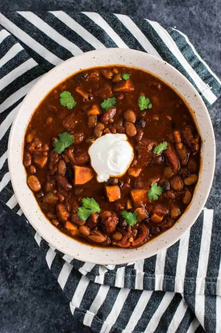 A large bowl of slow cooker vegetarian sweet potato chili.