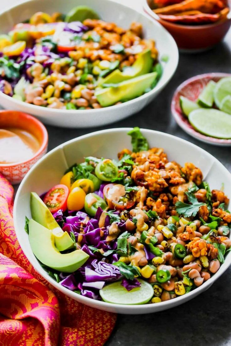 A delicious bowl of southwestern tempeh taco salad with chipotle-tahini dressing.
