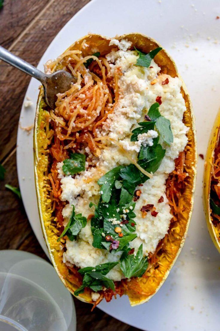 A fork twirled in a delicious spaghetti squash lasagna boat.