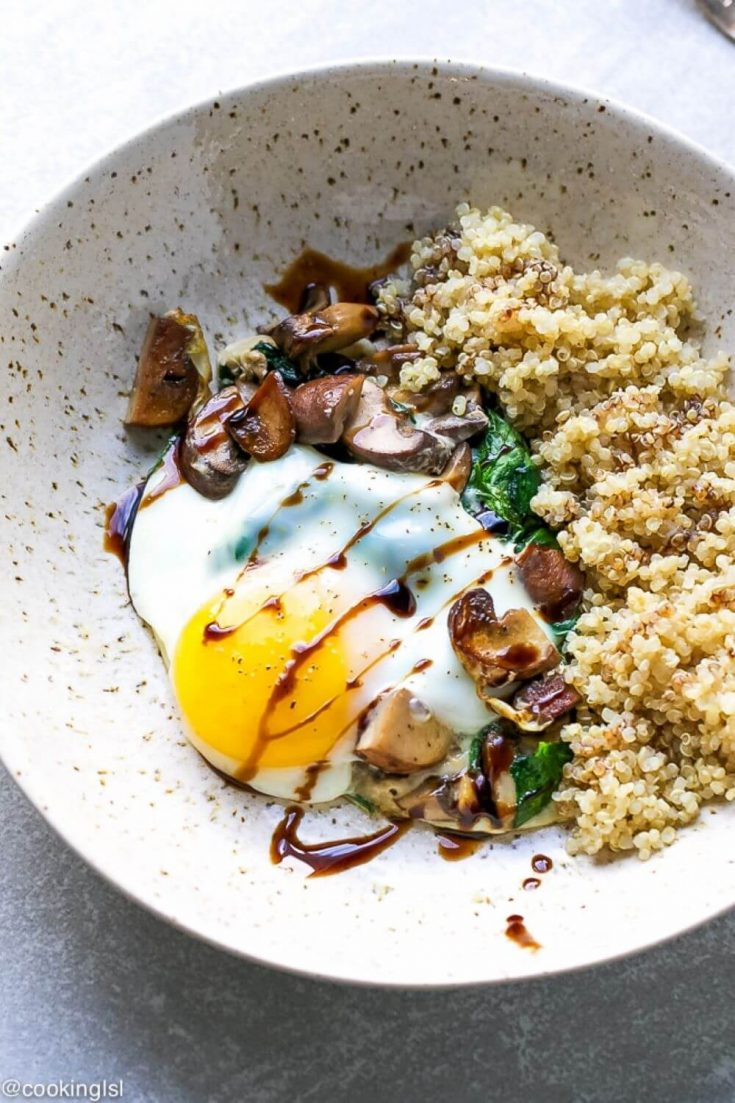 A large plate of spinach mushroom quinoa breakfast bowl.