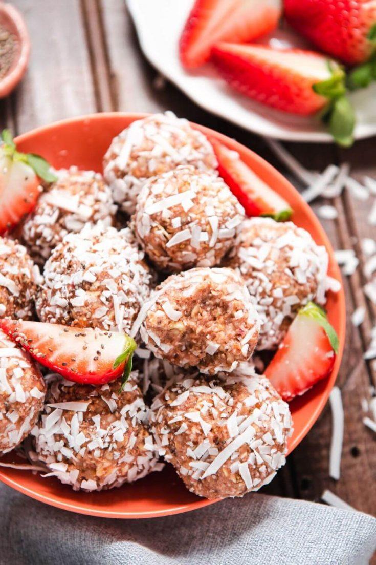 A bowl of no-bake strawberry almond energy balls.