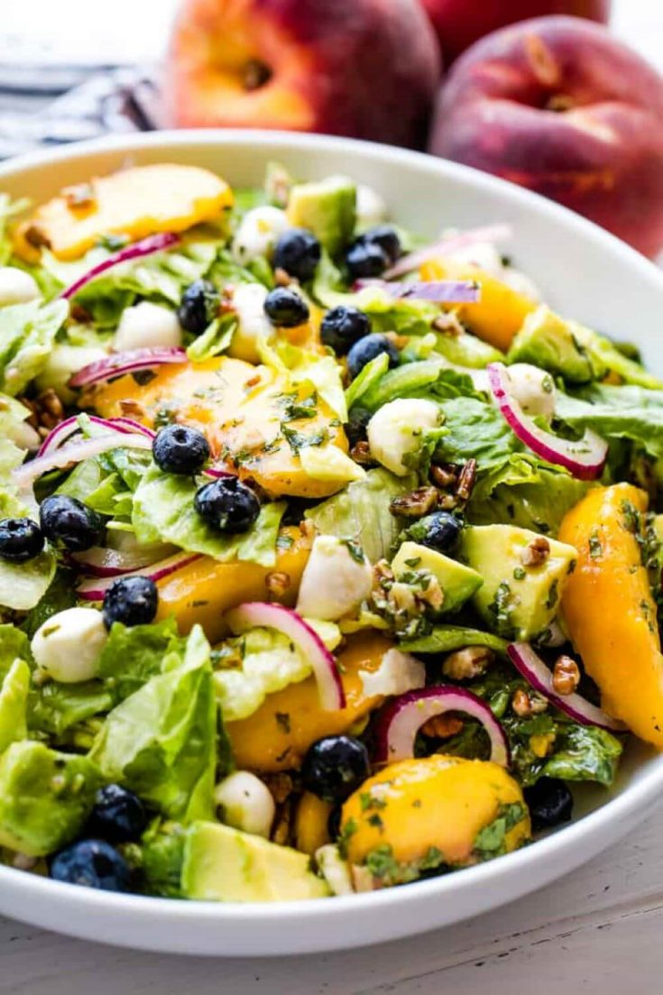 A large bowl of delicious summer peach salad.