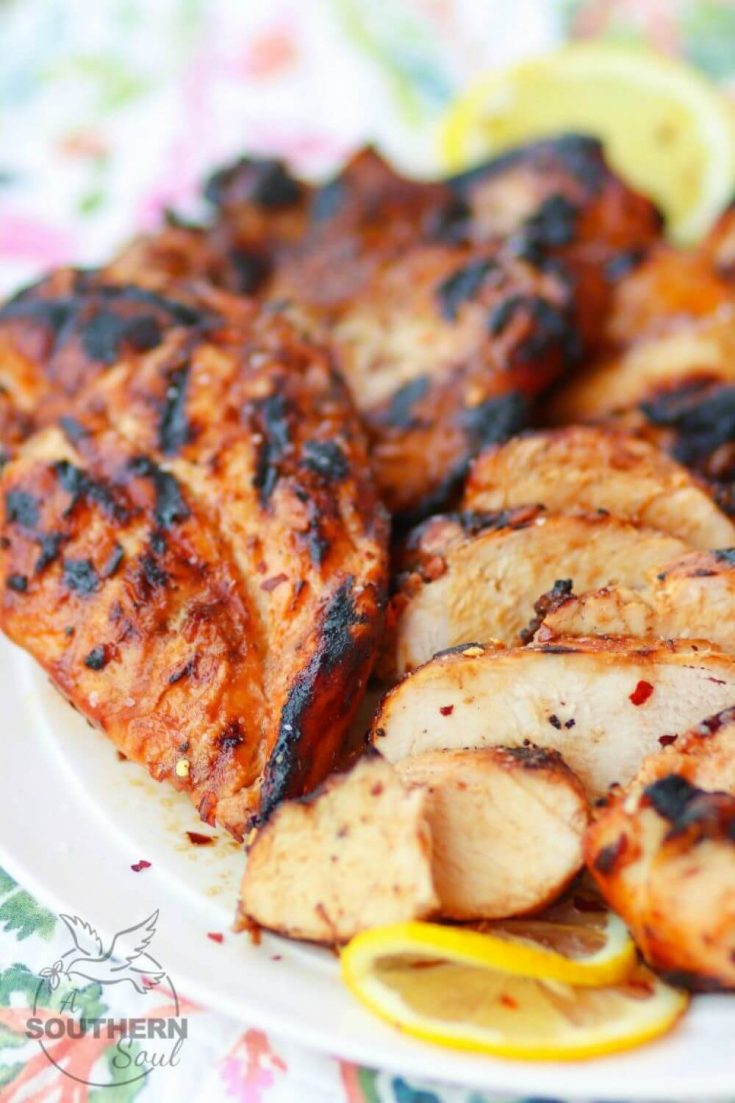 A closeup plate of sweet heat bbq grilled chicken.