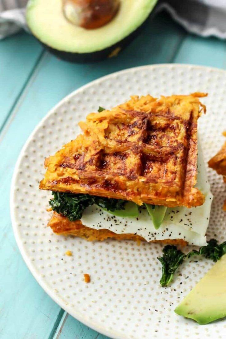 A sweet potato waffle breakfast sandwich on a plate.