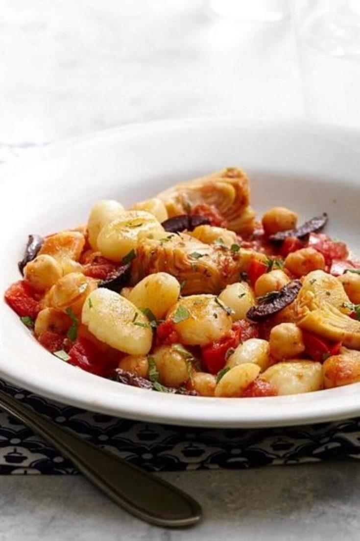 A large bowl of delicious tomato artichoke gnocchi.
