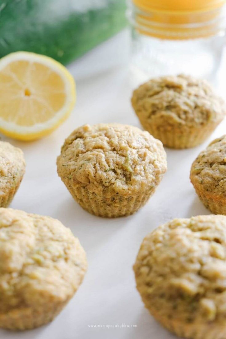 Several delicious and healthy lemon zucchini muffins.