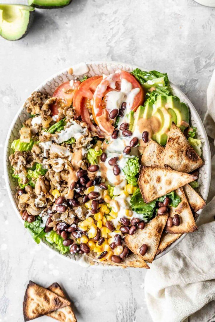 """A large bowl of vegan lentil """"meat"""" taco salad."""