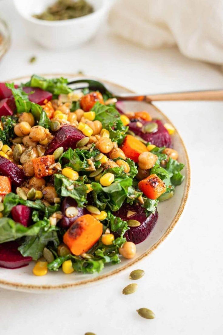 A delicious bowl of roasted beet salad with marinated chickpeas.