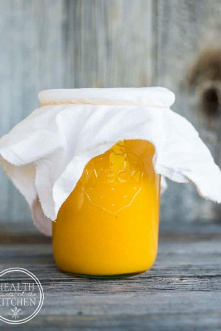 A mason jar full of lacto-fermented mango habanero hot sauce.