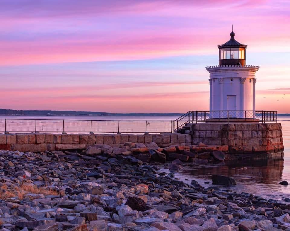 A beautiful sun-setting sky behind the lighthouse at Bug Light Park.