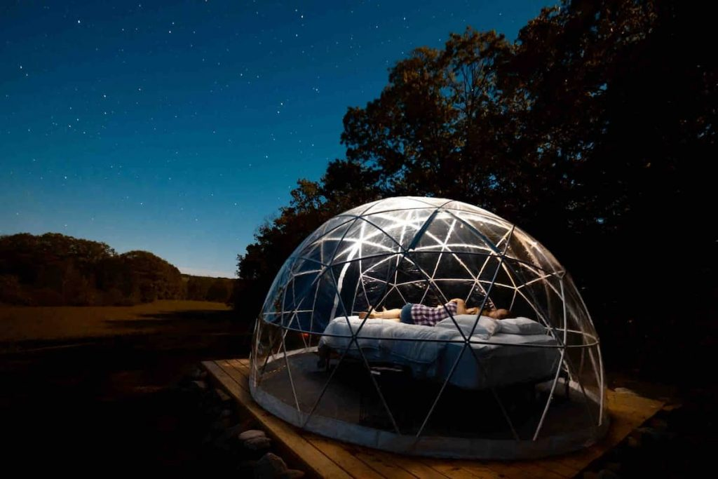 A geometric see-through dome for rent in the Maine woods.
