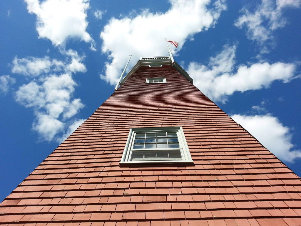 A view of the Portland Observatory tower from the ground looking up.