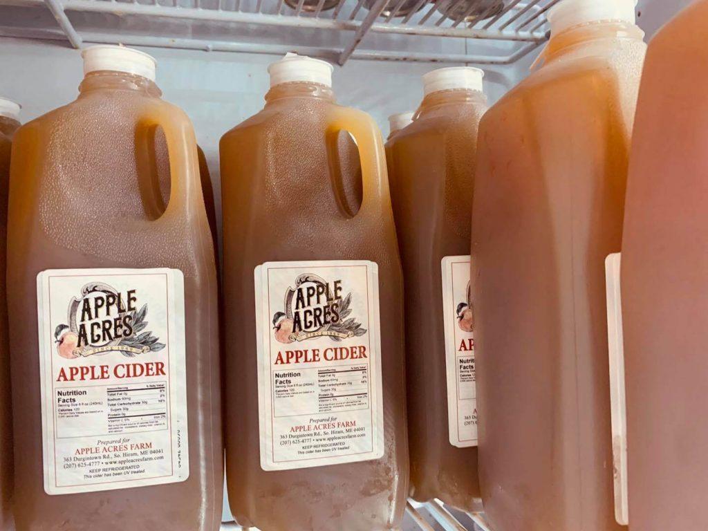 Several half gallon jugs of Apple Acres' apple cider.