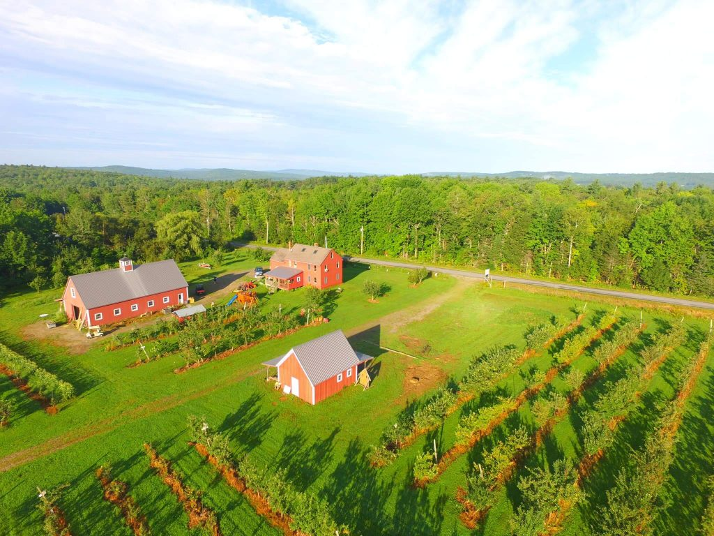 An overhead view of the apple orchard and farm buildings at Hooper's Orchard in Maine.