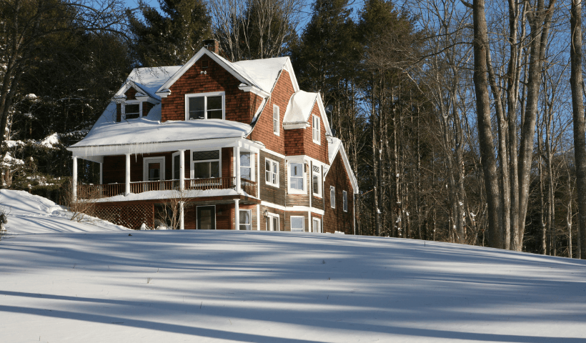 A snow-covered house offered as a winter rental in Maine.