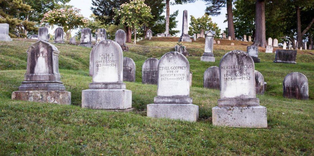 Several old headstones in Mount Hope Cemetery in Bangor, Maine.